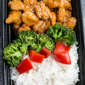 Orange chicken and rice in a meal prep container