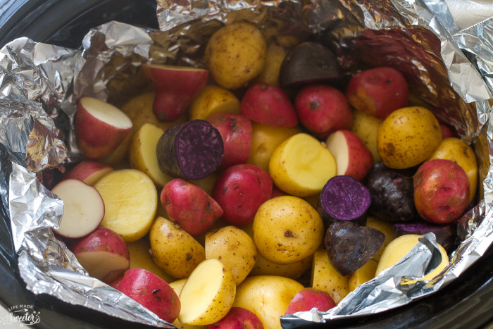 Slow Cooker Rosemary Garlic Tri-color Potatoes makes an easy side dish.