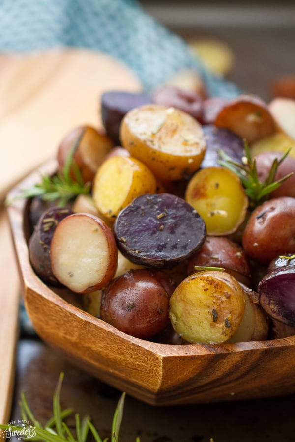 Tender and crisp tri-color potatoes loaded with rosemary, thyme, oregano, garlic and a sprinkle of parmesan. An easy an simple side dish made in the slow cooker.