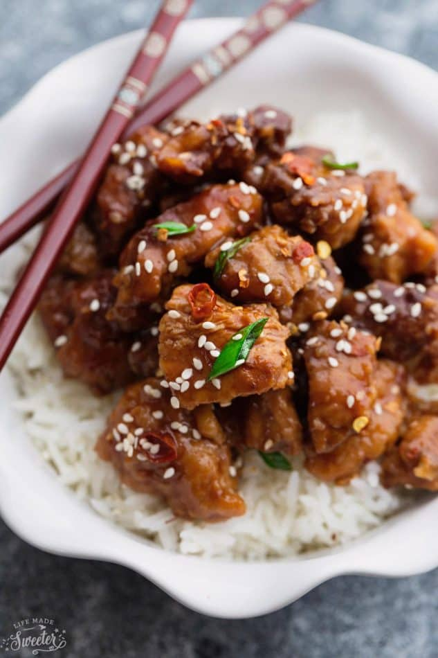 Slow Cooker Sriracha Chili Chicken recipe is the perfect easy weeknight dinner. Best of all, there is only 10 minutes of prep and is so much better than take-out. Simmered in a flavorful and spicy Sriracha chili sauce, this is sure to become a family favorite. Great for Sunday meal prep and leftovers are perfect for school or lunch bowls