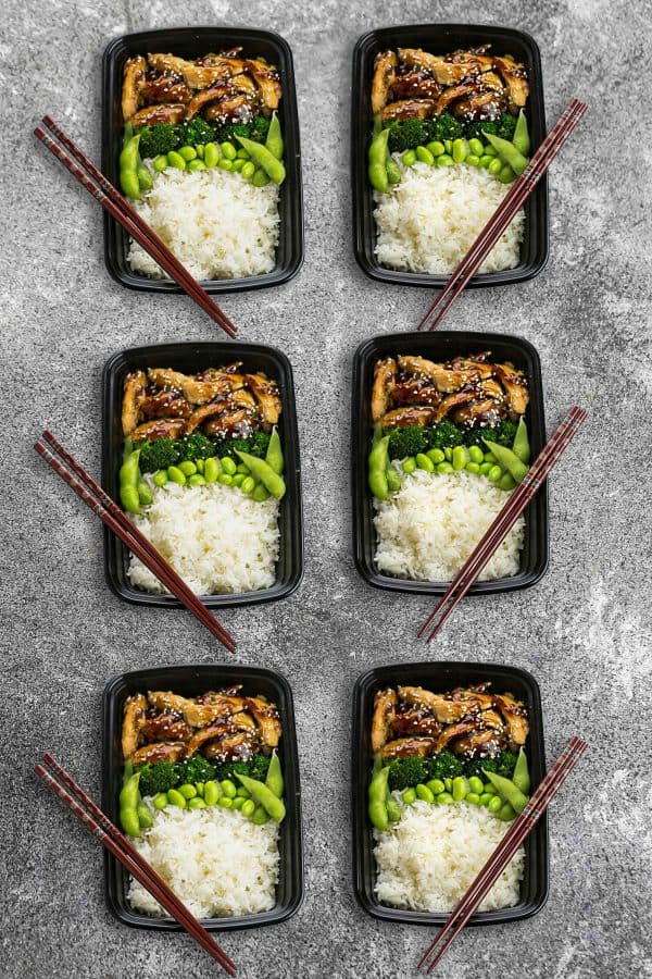 Six Chicken Teriyaki Bowls with dark brown chopsticks.
