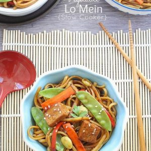 Overhead view of 3 bowls of Slow Cooker Vegetable Lo Mein with chopsticks