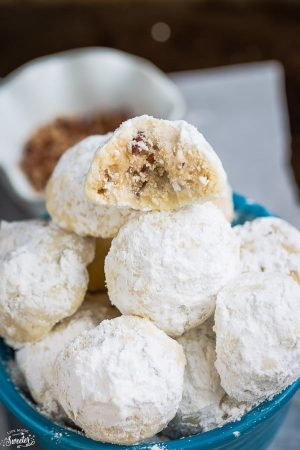 Top view of snowball cookies in blue bowl