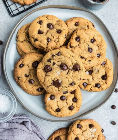 Top view of 9 keto chocolate chip cookies on a grey plate