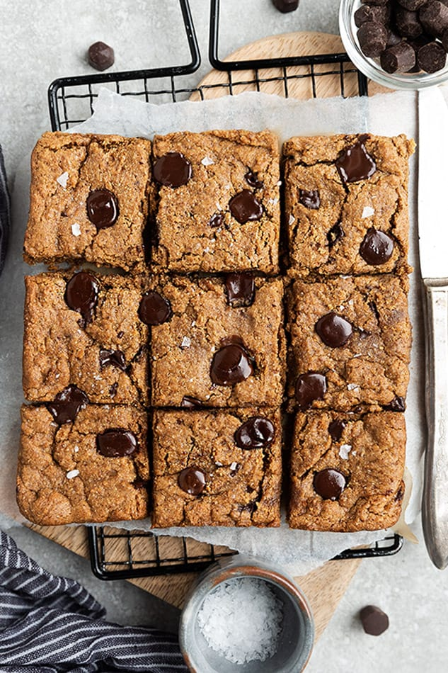 Overhead view of chocolate chip cookie bars garnished with flaked sea salt.