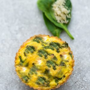 Spinach and Cheese Egg Muffins are quick, simple and make a perfect grab and go breakfast for busy mornings. Best of all, this recipe is easy to customize and the egg cups are low in carbs, keto friendly and packed with protein.