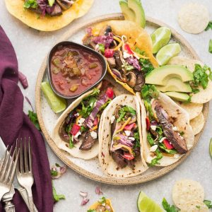 Grilled Steak Tacos are full of flavor and loaded with all the classic taco-truck toppings. Best of all, the steak is perfectly tender, juicy and perfect for Taco Tuesday or any day.