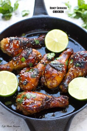 Sticky Honey Sriracha Chicken - Easy chicken drumsticks are loaded with zesty Asian flavor with the perfect balance of spicy, tangy & sweet.