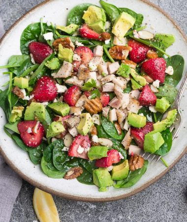 Strawberry Spinach Salad with Avocado, Chicken & Lemon Dressing - perfect healthy low carb / keto lunch made with fresh greens, avocado, nuts & cheese.