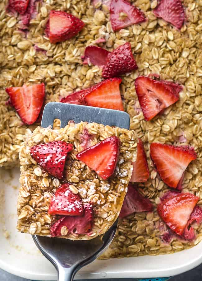 Strawberry Baked Oatmeal (Muffin Cups) - the perfect easy make ahead breakfast for spring and summer. Best of all, this recipe is simple to customize and made with gluten free oats, sweet and juicy fresh & freeze-dried strawberries and refined sugar free.