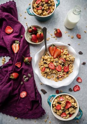 Strawberry Double Chocolate Granola makes the perfect gluten free breakfast or after school / pre or post workout snack. Loaded with crunchy clusters, shredded coconut, white and dark chocolate chips along with freeze-dried and fresh strawberries. Best of all, this recipe is gluten free and refined sugar free and works great for Sunday meal prep.