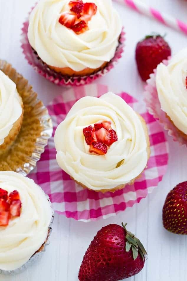 Strawberry Filled Vanilla Cupcakes make the perfect celebratory treat!