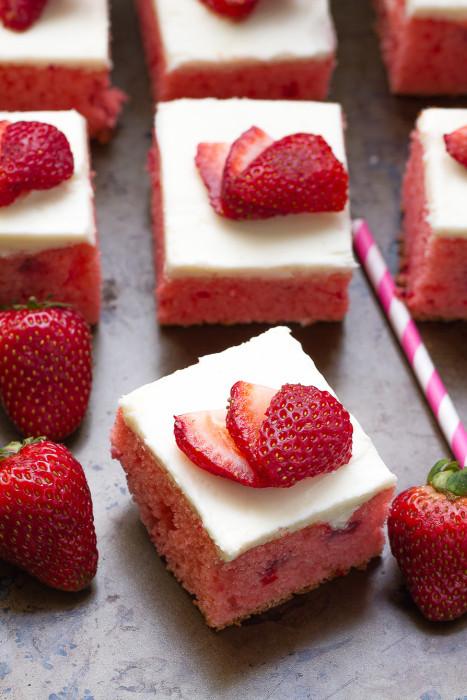 Strawberry Frosted Sheet Cake is bursting with loads of fresh strawberries and perfect for sharing at summer parties
