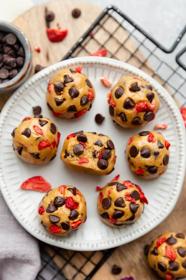 Overhead view of Strawberry Protein Balls with chocolate chips on a white plate