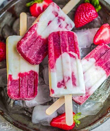 Top view of strawberry popsicles with fresh strawberries.