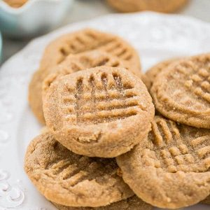 6 Soft and Chewy Keto Peanut Butter Cookies on a white plate