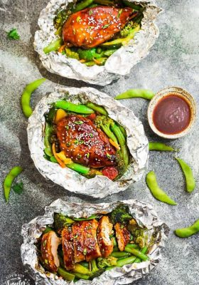 This recipe for Teriyaki Chicken Foil Packets with Vegetables is the perfect easy campfire or weekly dinner for summer. A complete meal with practically no clean up and full of your favorite sweet and savory Asian-inspired meal with tender chicken, edamame, broccoli, pineapple and red bell pepper. Make a batch for Sunday meal prep and pack it up for your lunchbox or lunch bowls. Foil packets are great for camping or busy weeknights.