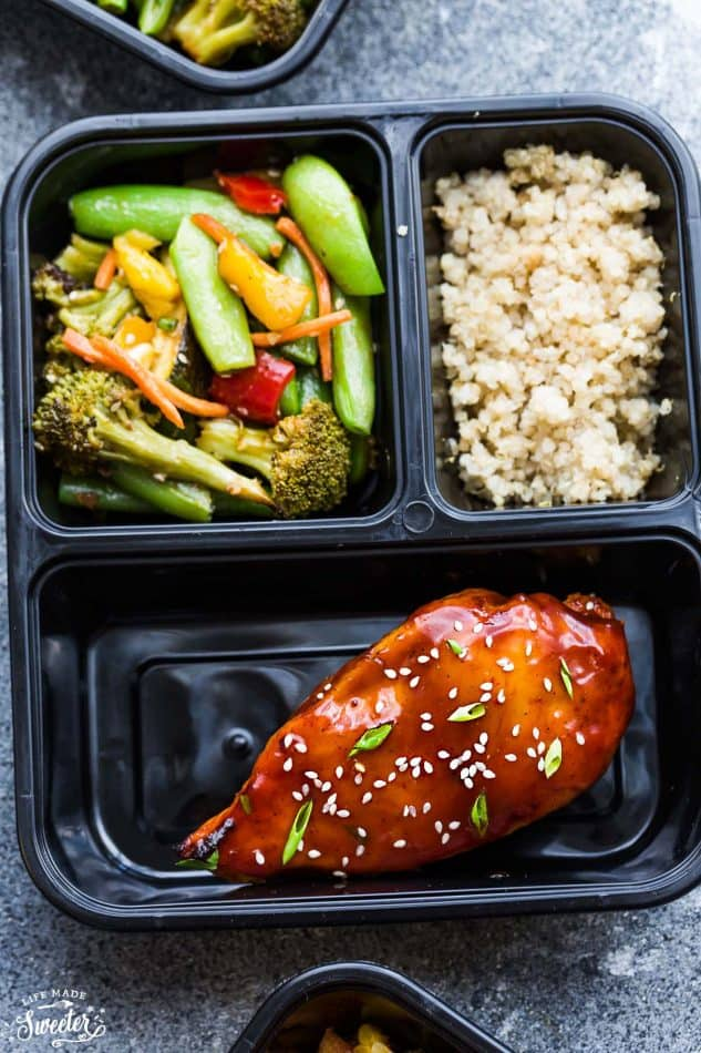 Top view of a divided container with Teriyaki Chicken, vegetables and rice