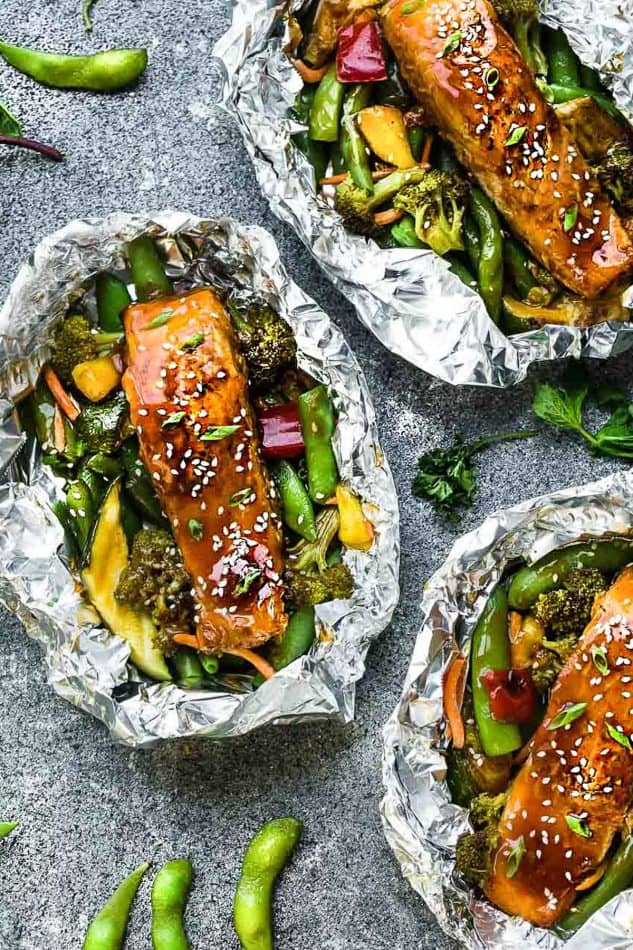 Top view of three Teriyaki Salmon Foil Packets with Vegetables