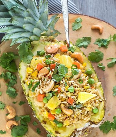 homemade Pineapple Fried Rice served in half of a whole pineapple