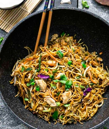 Top view of Chicken Chow Mein in a wok with chopsticks