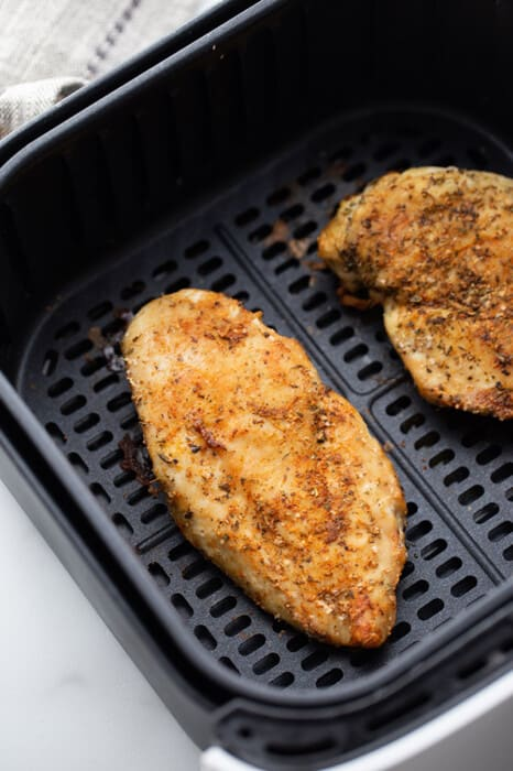 Top view of air fryer chicken in the air fryer