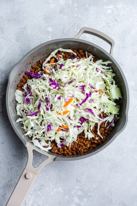 Cabbage slaw with ground meat in a grey pan