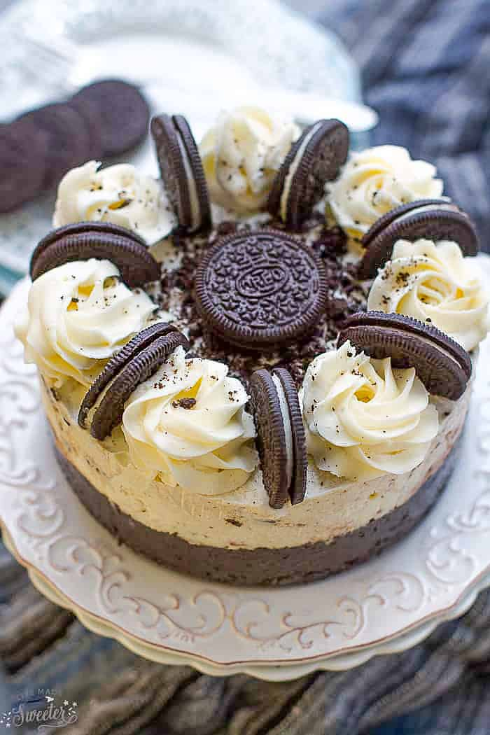 Top view of Oreo ice cream cake on white plate tiooed with Oreos