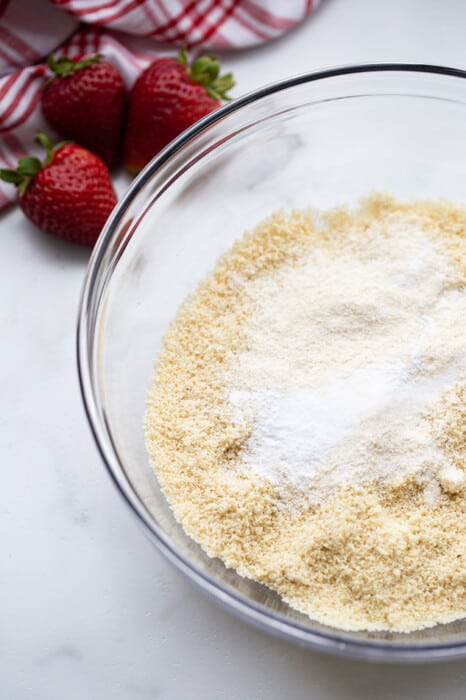 A clear mixing bowl of the dry ingredients to make strawberry shortcake