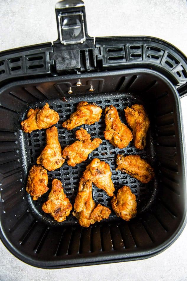 Crispy chicken wings in an Air Fryer basket