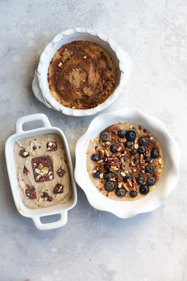 Blueberry Muffin, Churro and PB&J Baked Oats on a Marble Countertop