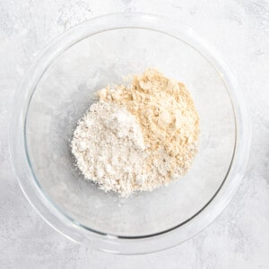 dry ingredients for baked oats in a glass mixing bowl