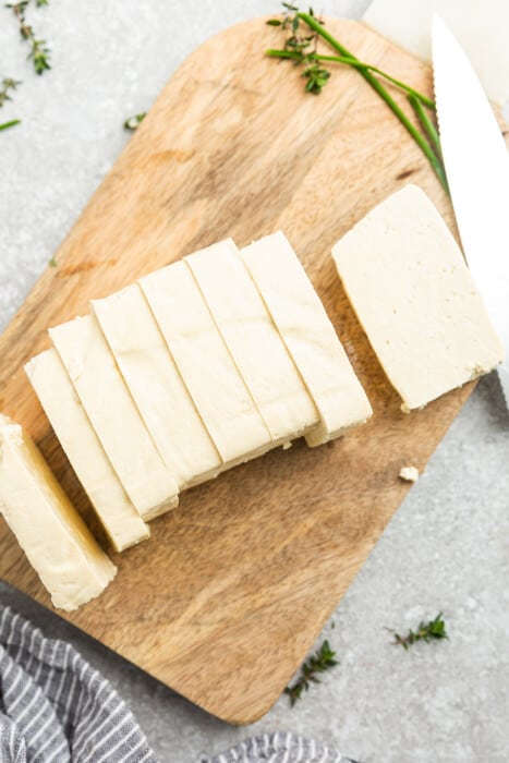 Top view of a block of tofu cut into strips