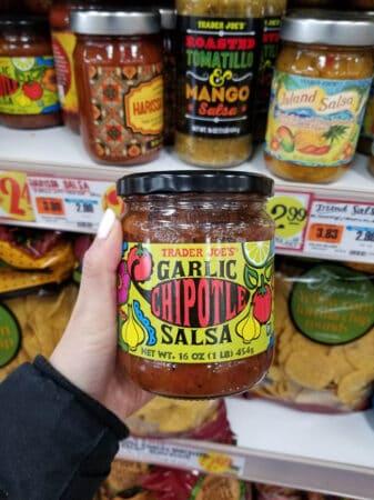A jar of Trader Joe's Garlic Chipotle Salsa