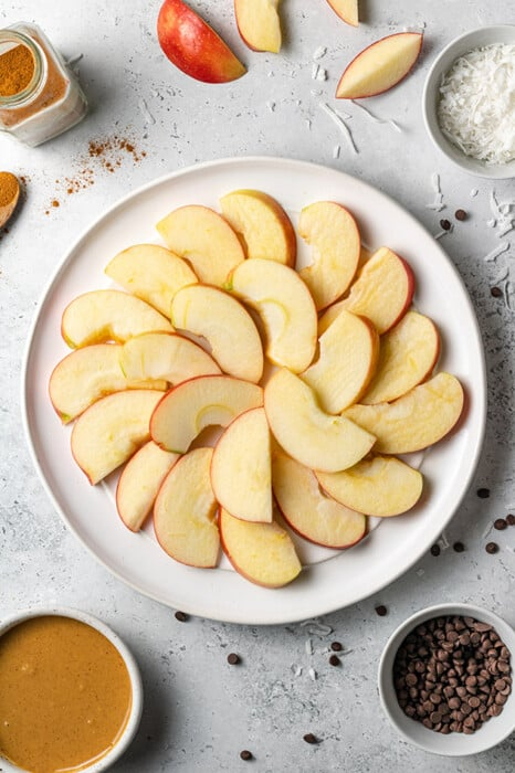 Overhead view of apple slices arranged on a plate