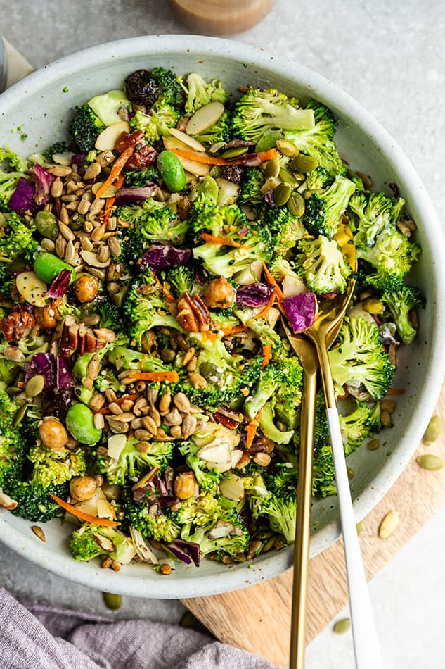 Top view of vegan broccoli salad in a white bowl
