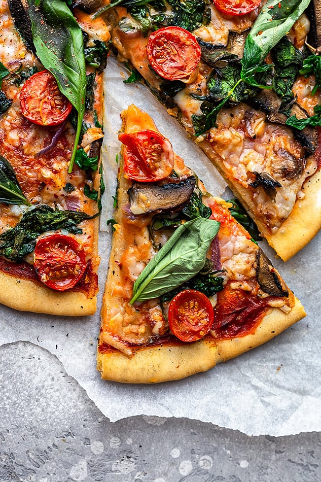 Overhead view of Vegan Pizza with a slice cut