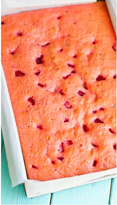Top view of baked strawberry cake batter in a rectangle cake pan