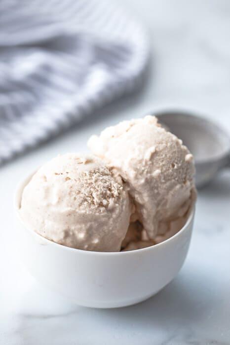 Portrait side photo of vegan vanilla ice cream in a white bowl