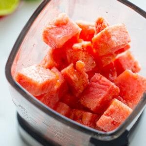 Cubes of Frozen Watermelon Inside of a Glass Blender