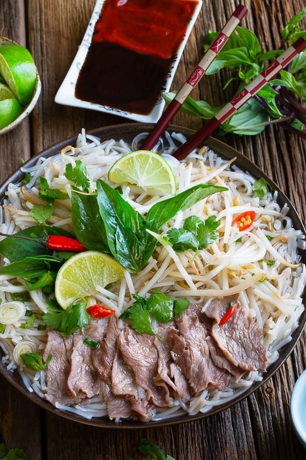 Vietnamese Pho Bo Rice Noodles make the perfect comforting meal. Best on those cold chilly nights!