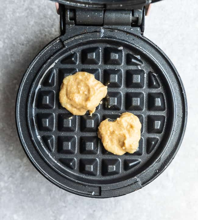 Image of waffle batter inside waffle maker.