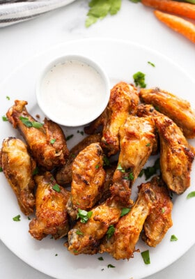 Air Fryer Chicken Wings on a white plate with a side of ranch dip