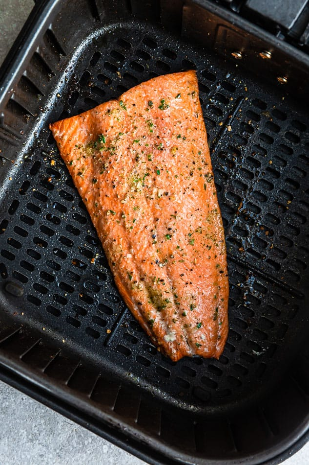 One Big Salmon Fillet in a Black Air Fryer Basket