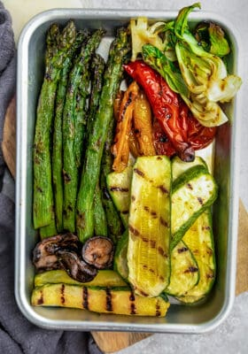 Top view of grilled vegetables on a baking sheet