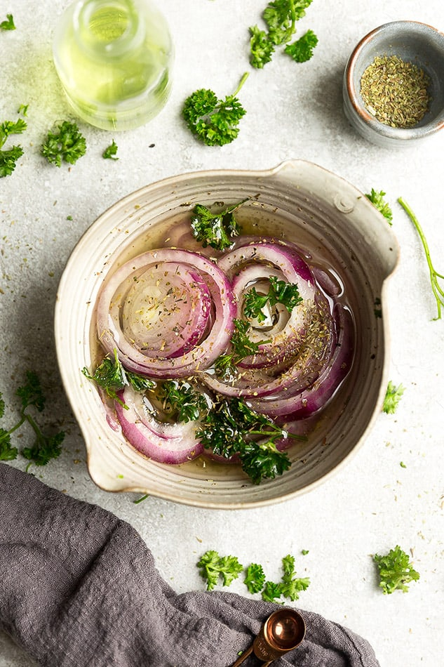 Overhead image of easy pickled red onions with parsley.