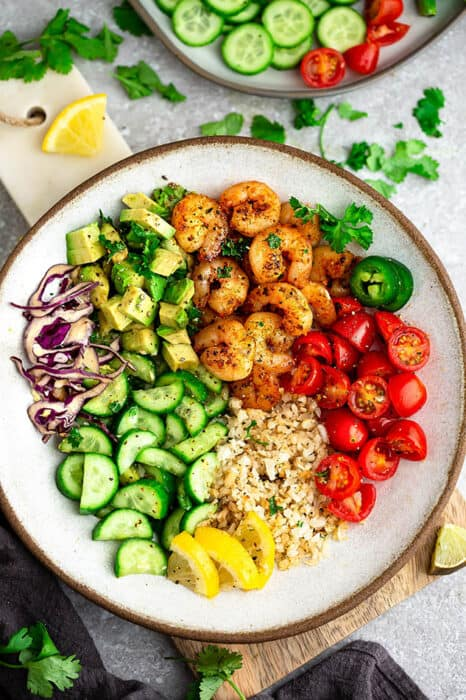 Top view of Whole30 Shimp Taco bowl ingredients in a white bowl