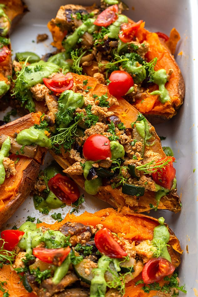 A Close-Up Shot of Vegan Stuffed Sweet Potatoes in a Baking Dish
