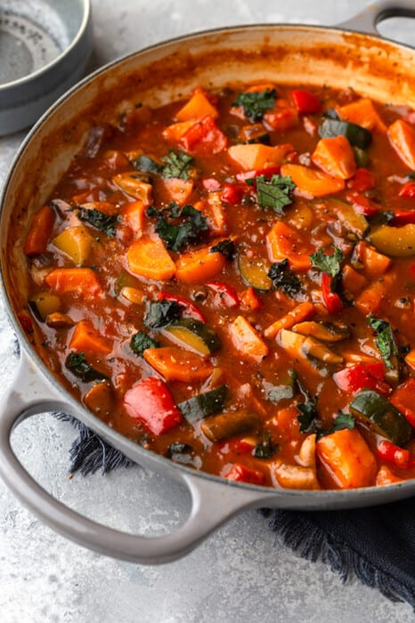 Side view of Whole30 vegetable stew in a pot with a spoon