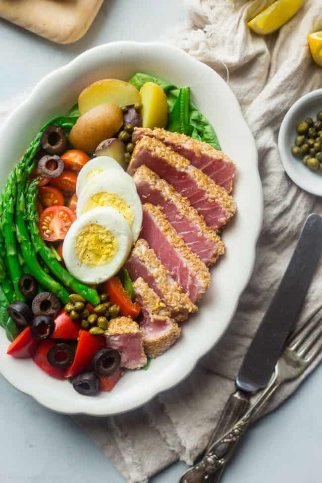 Overhead view of Asian Nicoise Salad in a white oval bowl